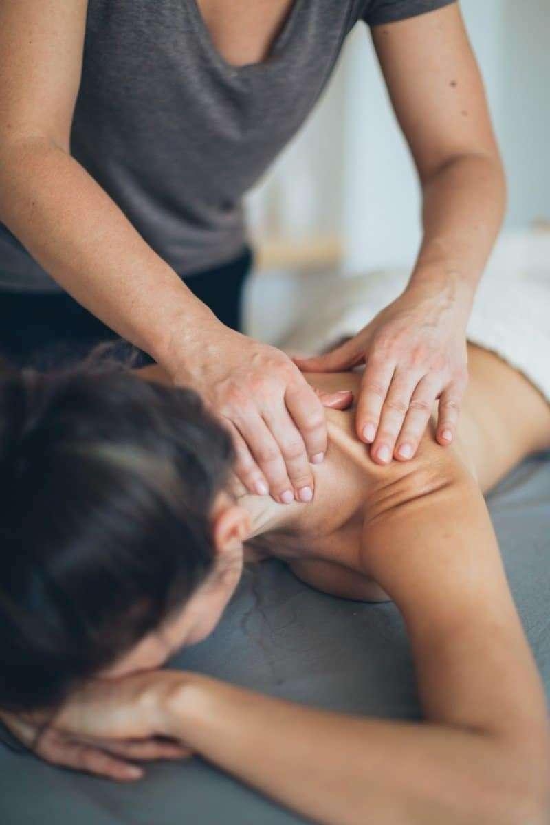 A woman benefitting from a massage