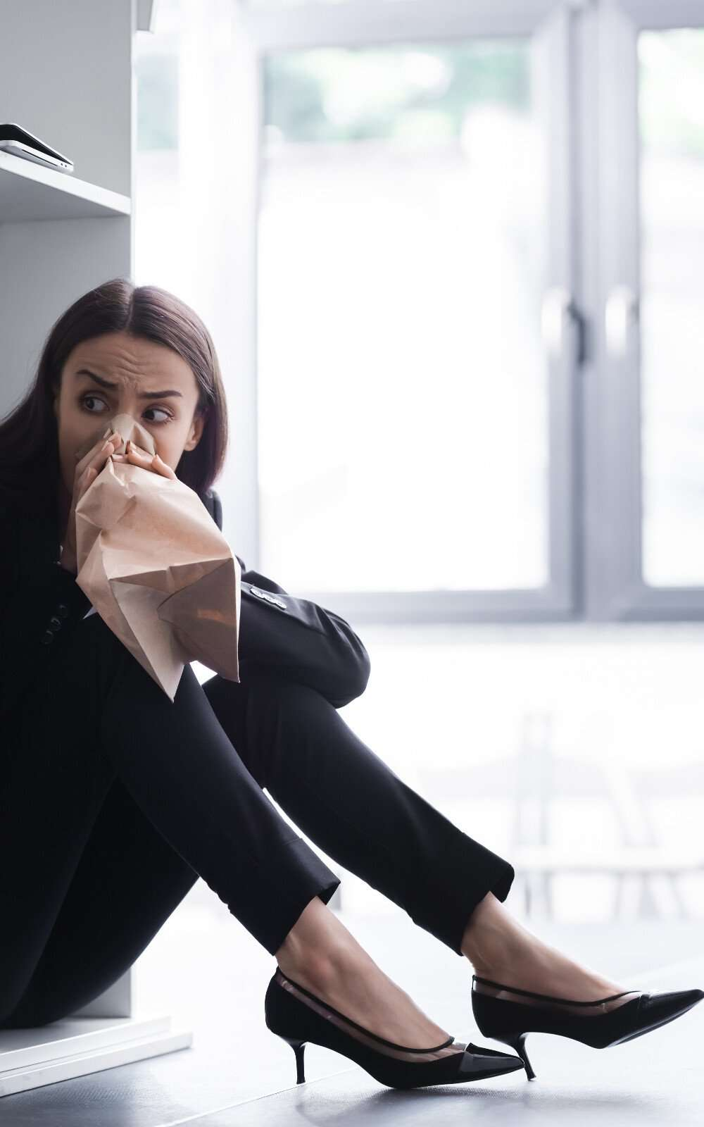 a woman hyperventilating because of a fear of speaking in public